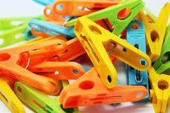 Multi-colored clothespins lying on the heap, close distance stock photos