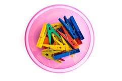 Clothespins colorati con la ciotola Immagine Stock Libera da Diritti