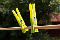 Clothespins. Colorful clothespins hanging in a row on clothesline Royalty Free Stock Photos