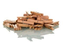 Clothespins di legno isolati su bianco Fotografia Stock