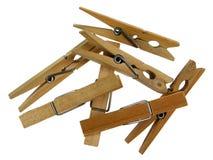 Clothespins di legno su priorità bassa bianca Fotografie Stock Libere da Diritti