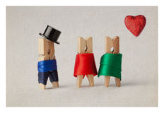 Clothespins: Gentleman in black hat and women (woman in red red and green d Royalty Free Stock Images