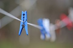 Clothespins hang on a cord. Colored clothespins hang on a cord outside of home Stock Photography