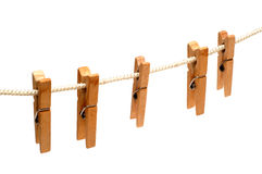 Clothespins hang on a linen cord. Isolated Royalty Free Stock Image