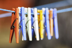 Clothespins. Hanging on a clothesline Royalty Free Stock Image
