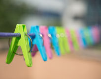 Clothespins hanging on steel wire Royalty Free Stock Images
