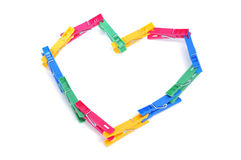 Clothespins heart Stock Images