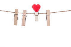 Clothespins with heart  shape  clip on a clothesline Royalty Free Stock Photo