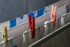 Clothespins hold stirannoe underwear to the dryer.  stock photo