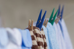 Clothespins holding clothes on the clothesline Royalty Free Stock Image