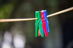 Clothespins on a leash in the garden. Line Stock Image