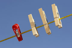 Clothespins on the line. A row of clothespins on the line Royalty Free Stock Photography