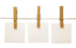 Clothespins and notepads Stock Images