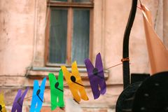 Clothespins from paper hanging on a rope. royalty free stock photo