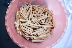 Clothespins In A Pink Bucket. Bunch of wooden clothespins in pink bucket Stock Photo