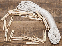 Clothespins on rope Stock Image