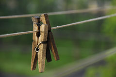 Clothespins on rope. Two wooden clothes pins on cord outdoors royalty free stock images