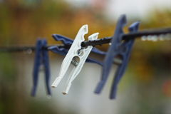Clothespins on a rope. Royalty Free Stock Images