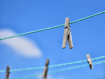 Clothespins on rope Stock Photos