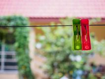 Clothespins on rope. Colorful clothespins hanging on rope Royalty Free Stock Image