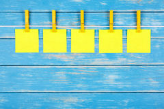 Clothespins on a rope with five cards Royalty Free Stock Photography