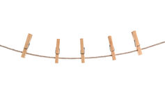 Clothespins. On rope isolated on a white background Stock Photography