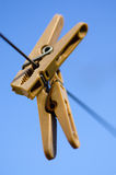 Clothespins on rope. Two clothespins on a rope on the background of sky Royalty Free Stock Photo