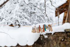 Clothespins on a rope under snow Stock Photo