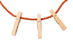 Clothespins on rope Stock Photography