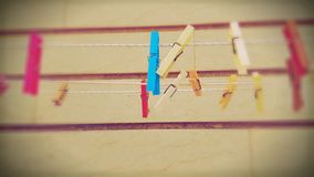 Clothespins on ropes Royalty Free Stock Image