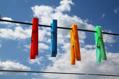 Clothespins in the sky. A coloured clothespins with sky background Stock Photography