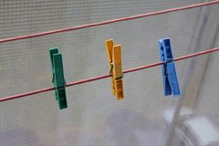 Clothespins. There are green, yellow and blue clothespins on the picture Royalty Free Stock Photo