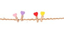 Clothespins with valentines  on rope Royalty Free Stock Photography