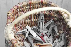 Clothespins in a wicker basket.  royalty free stock image