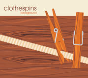 Clothespins on the wooden background Stock Photography