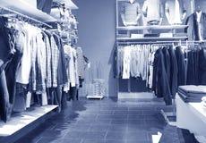 Clothinewinkel van mensen Stock Foto's