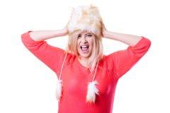 Woman wearing winter furry warm hat Royalty Free Stock Image