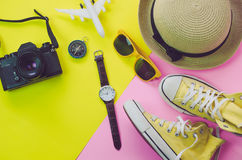 Clothing accessories for summer on multicolor paper floor Royalty Free Stock Image