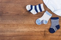Clothing for baby boy, expecting for newborn concept, place for text on rustic board. Blue clothing for baby boy, expecting for newborn concept, place for text stock photography