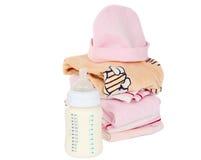 Clothing and baby milk bottle Stock Image