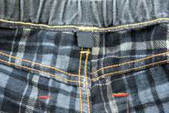 Clothing back side of jeans with blank tag Royalty Free Stock Photo