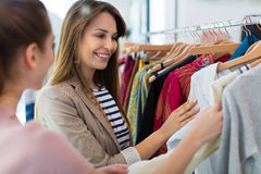 Clothing boutique. Young women shopping in a boutique Royalty Free Stock Image