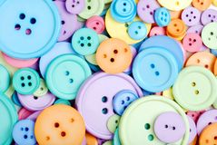 Clothing buttons. Lots of clothing buttons making a background Stock Photo