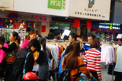 Clothing commercial street in the new year`s Day landscape, people go shopping or buy clothing Stock Image