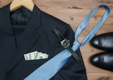 Clothing concept. jacket hanger. tie dollars Watch Royalty Free Stock Photos
