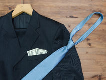 Clothing concept. jacket and hanger. tie dollars Royalty Free Stock Photo