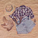 Clothing in country style on old papper background Stock Image