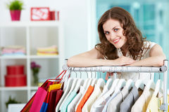 In clothing department. Portrait of happy woman looking at camera in clothing departmant Stock Photo
