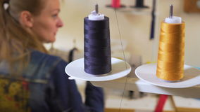 Clothing designer is working with measurements on a studio table. 4K UHD. stock video footage