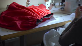 Clothing designer is working with measurements on a studio table. 4K UHD. stock video